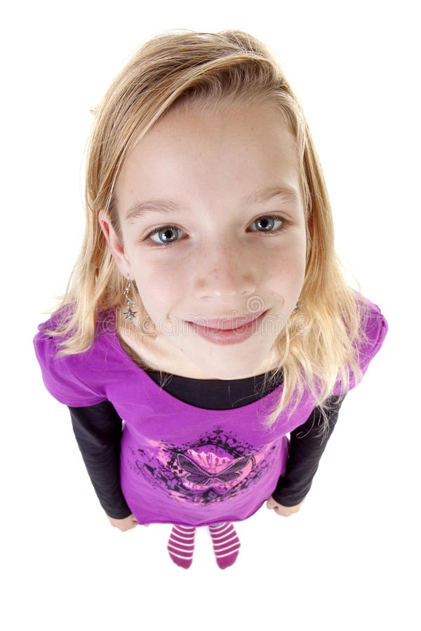 Teenage girl in studio seen from above; big head little feet. Over white background stock image