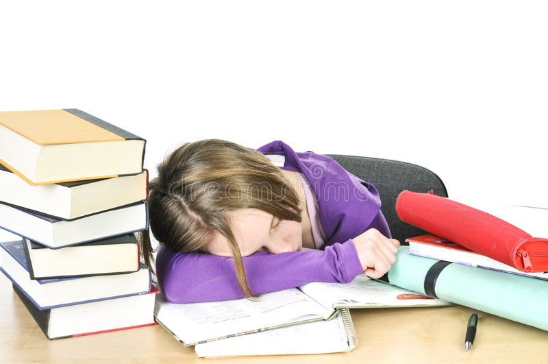 Teenage girl studying. At the desk being tired royalty free stock images