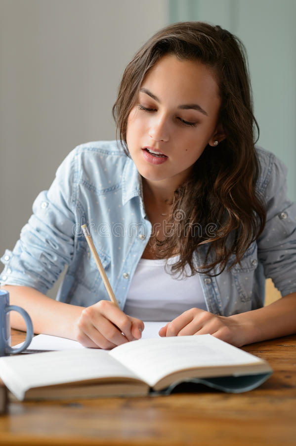 Download Teenage Girl Studying Book Writing Notes Stock Image - Image: 42704967