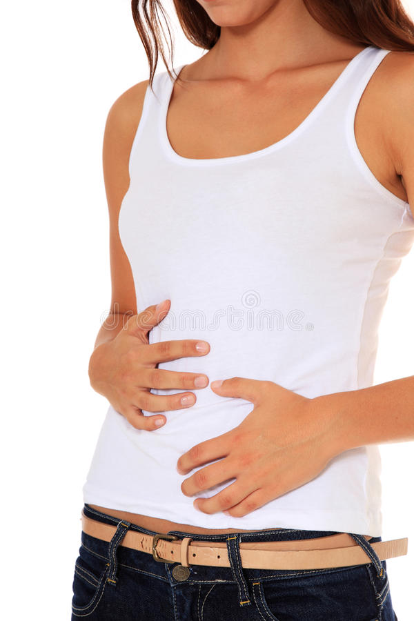 Teenage Girl Suffers From Stomach Cramps Stock Photography