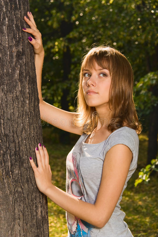 Teenage girl in summer park stock images
