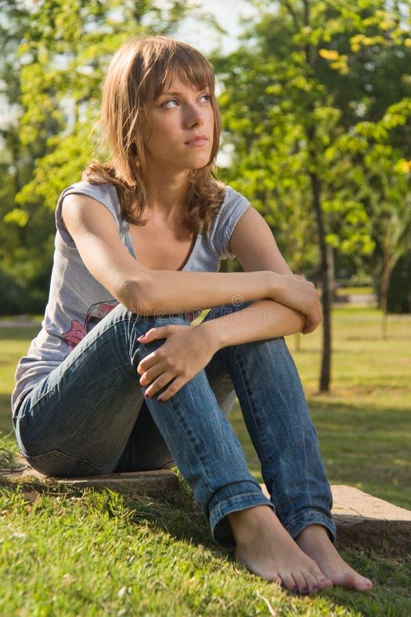 Teenage girl in summer park stock photo