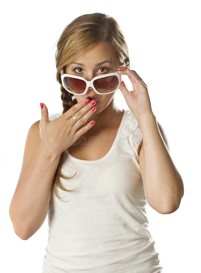Teenage girl with sunglasses surprised on white royalty free stock image