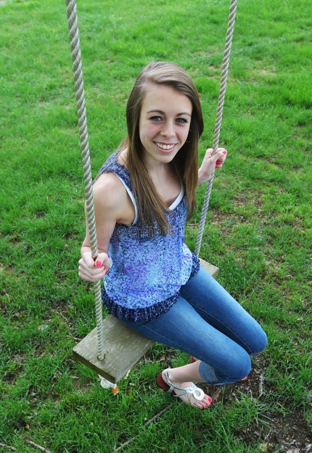 Teenage Girl on Swing royalty free stock photo