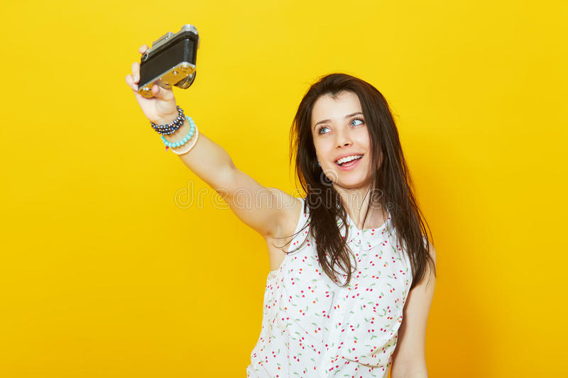 Teenage girl taking a self portrait with retro camera royalty free stock photos