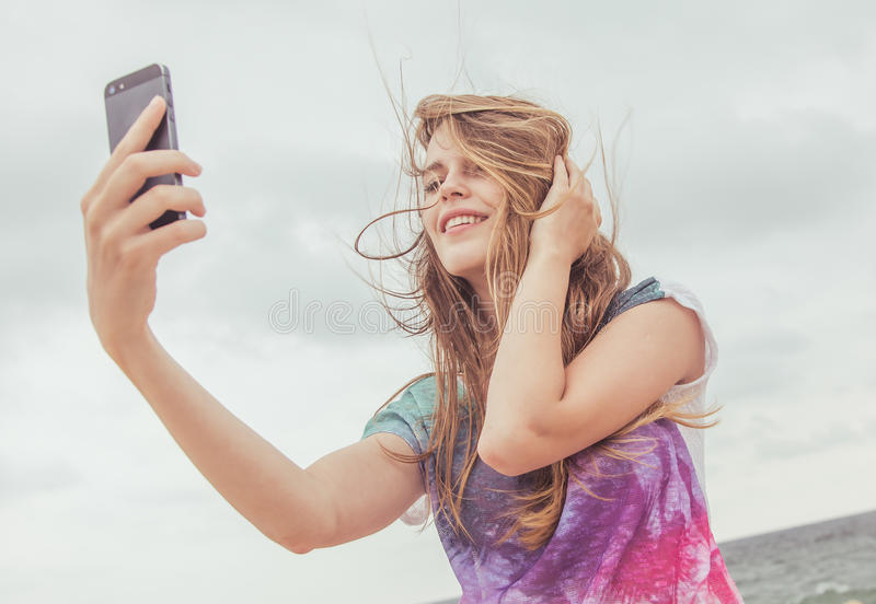 Teenage girl taking selfie stock photo