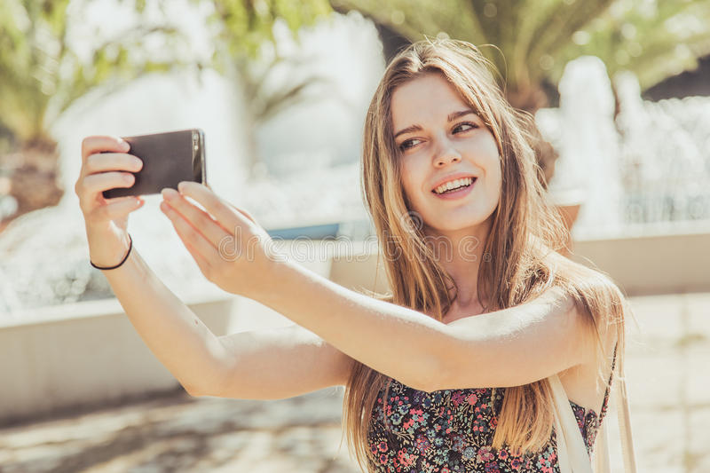 Teenage girl taking selfie royalty free stock photos