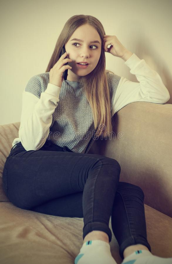 A teenage girl is talking on the phone royalty free stock images