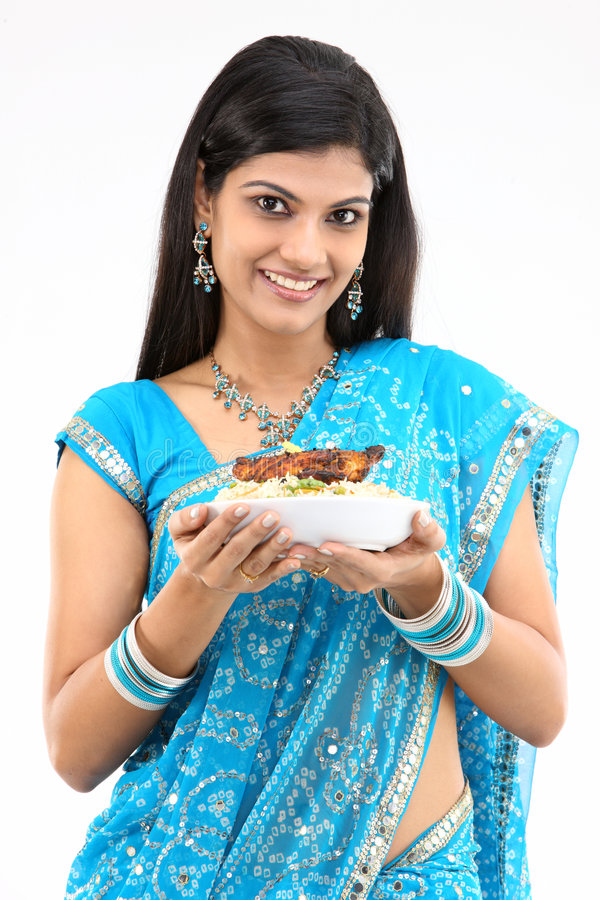 Teenage girl with tasty rice and chicken