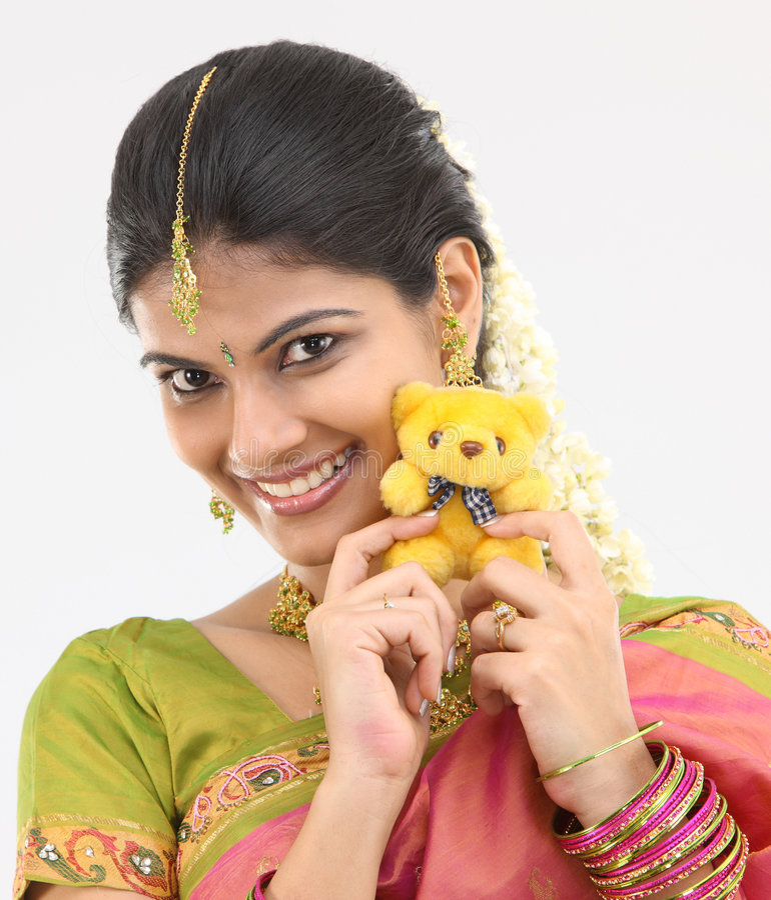 Teenage girl with teddy bear stock photo