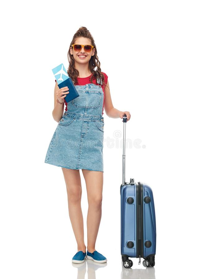 Teenage girl with travel bag and air ticket stock photos