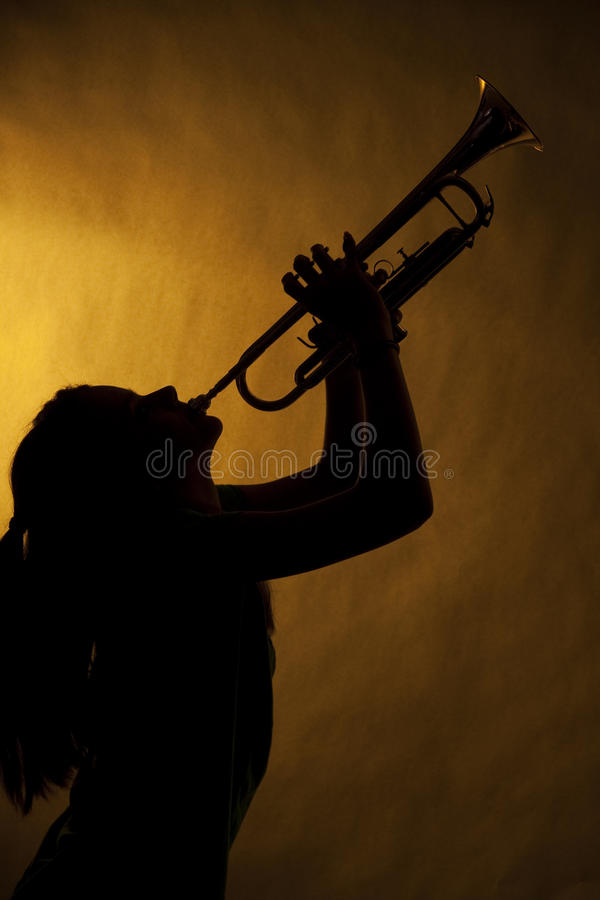 Teenage Girl Trumpet Player In Silhouette stock photos