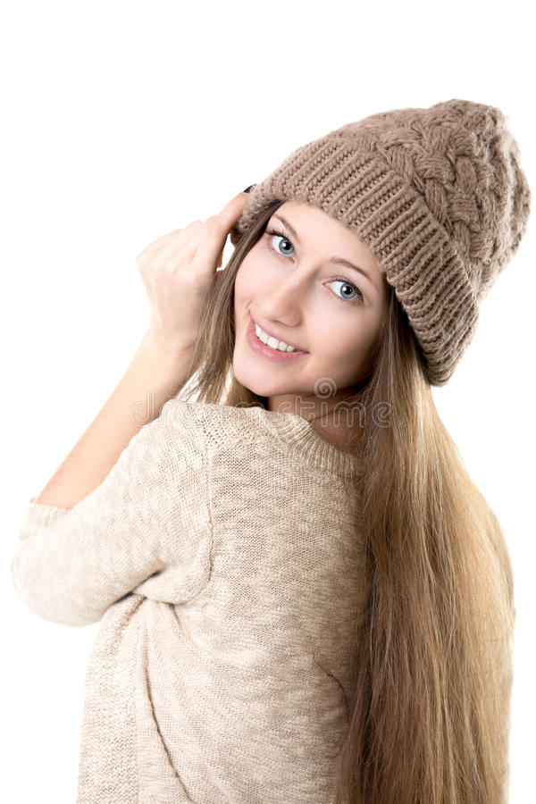 Teenage girl trying on knitted hat royalty free stock images