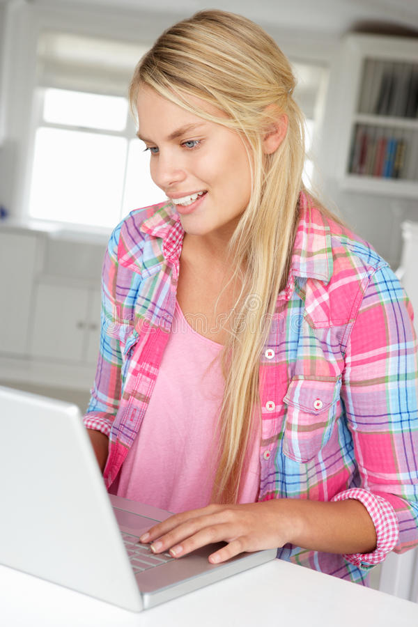 Download Teenage girl using laptop stock photo. Image of relaxed - 21044028