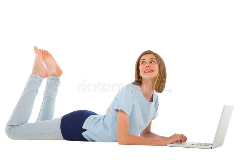 Teenage girl using laptop royalty free stock photos