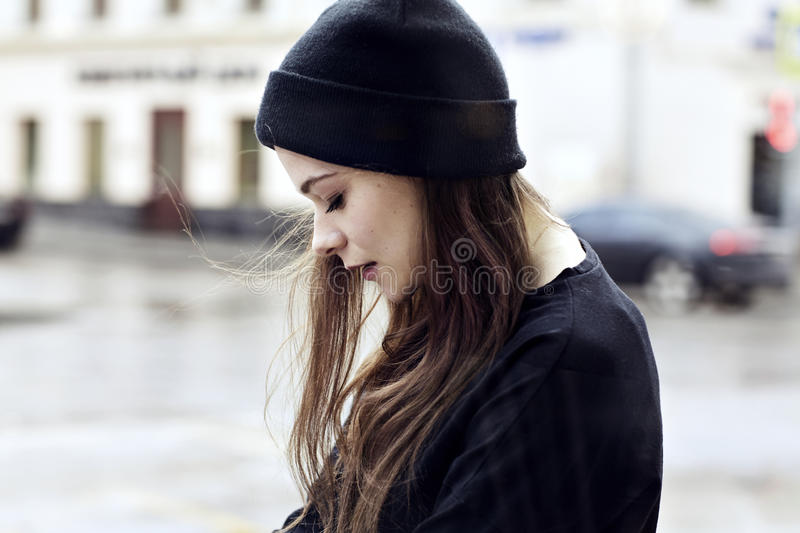 Teenage girl walking alone. Hair flying in the wind stock photos