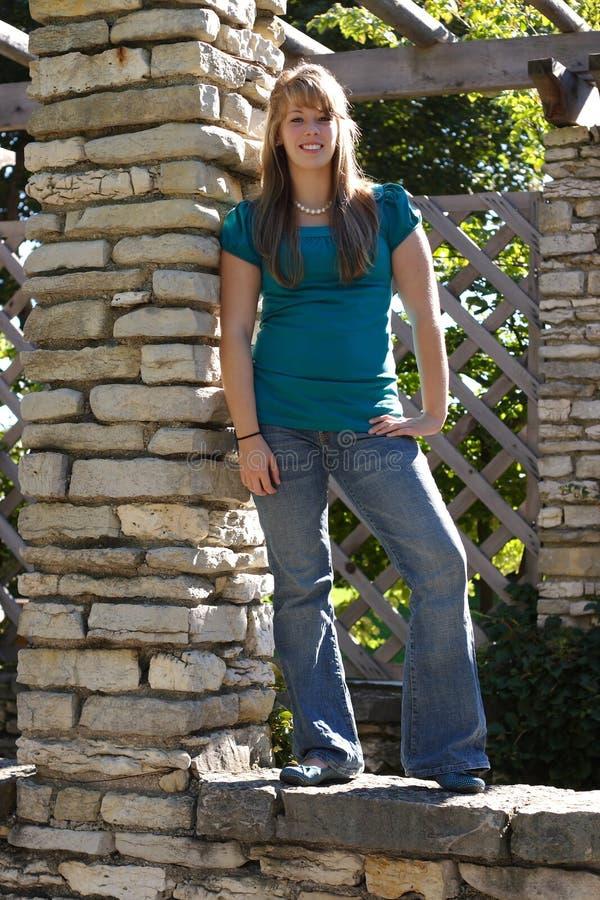 Teenage Girl on a Wall stock photography