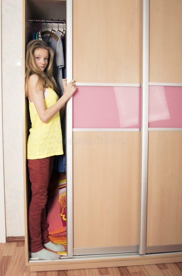 Teenage girl in wardrobe at home stock image