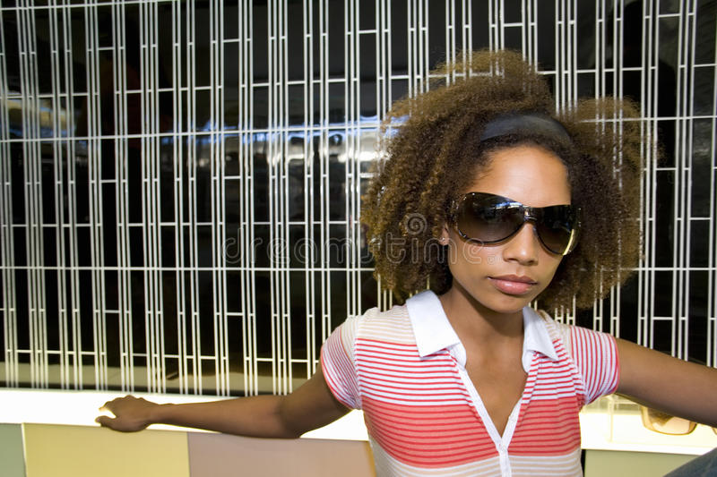 Teenage girl wearing sunglasses, close-up stock photo