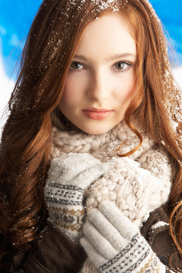 Teenage Girl Wearing Warm Winter Clothes In Studio stock images
