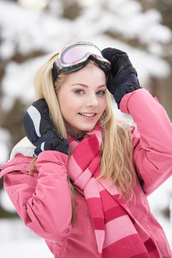 Teenage Girl Wearing Winter Clothes In Snow Stock Photo
