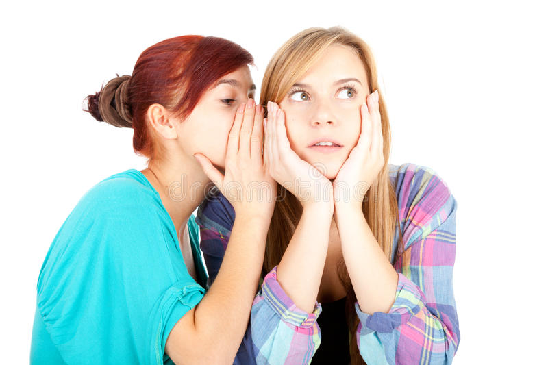 Download Teenage Girl Whispering In Friend`s Ear Stock Photo - Image: 21751010