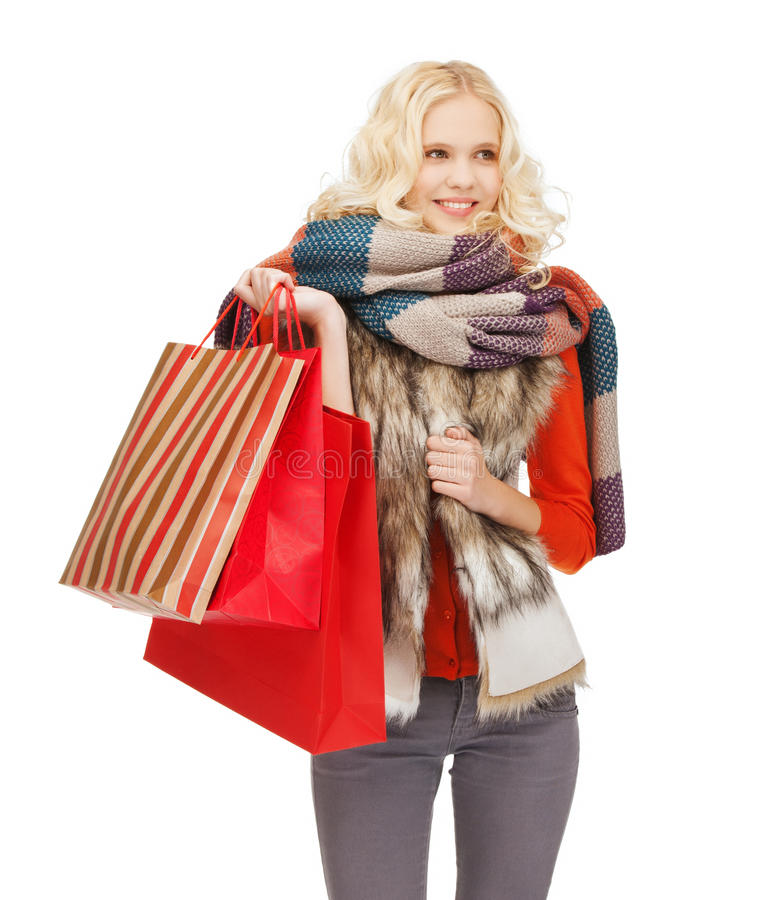 Download Teenage Girl In Winter Clothes With Shopping Bags Stock Photo - Image: 34953730