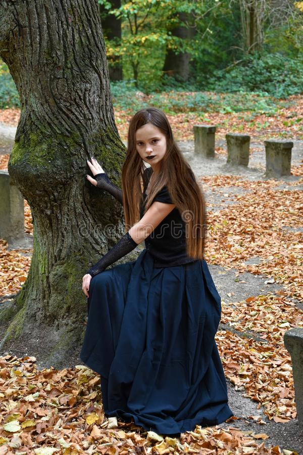 Teenage girl with wonderful hair in autumn forrest royalty free stock photos