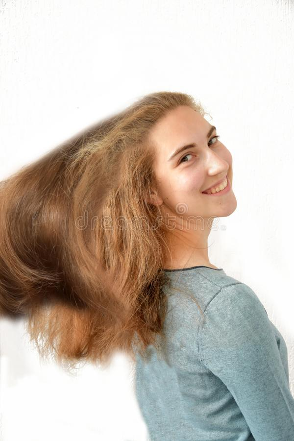 Teenage girl with wonderful long blond hair royalty free stock images