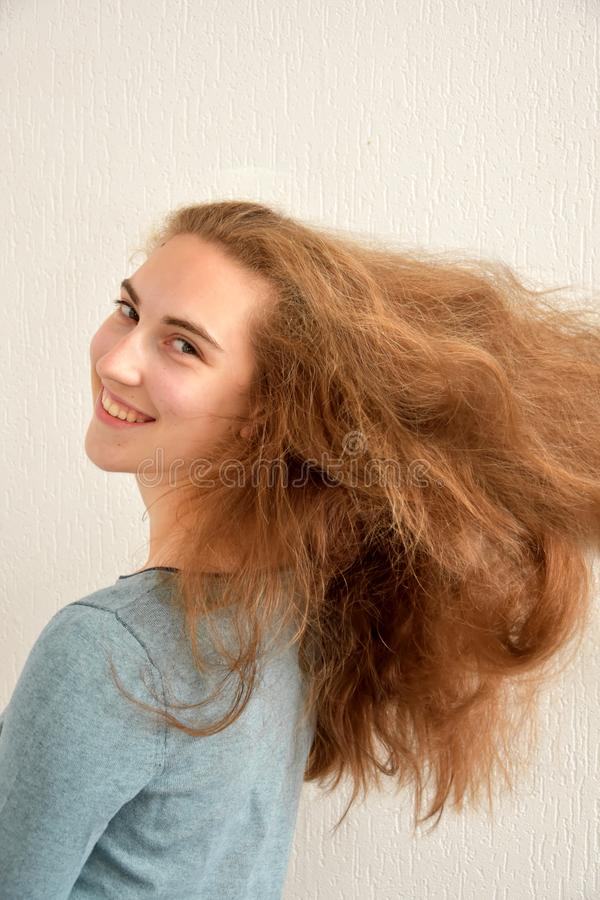 Teenage girl with wonderful long blond hair royalty free stock image