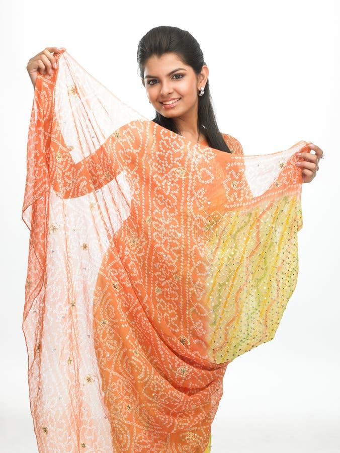 Teenage girl in yellow sari stock photography
