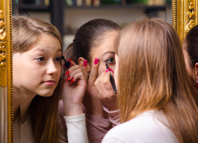 Teenage Girlfriends Having Fun While Putting Make Up Stock Photography