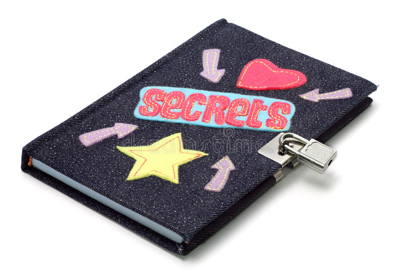Teenage Girls Diary. Notebook/diary with denim cover, sown on shapes and locked padlock, on white background stock photos