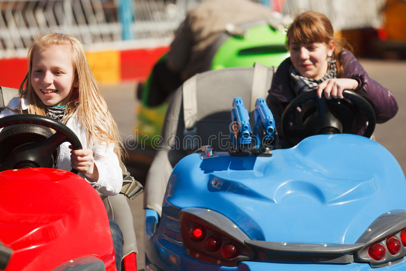 Teenage Girls Driving A Bumper Cars Stock Images