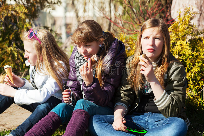 Teenage girls eating an ice cream royalty free stock images