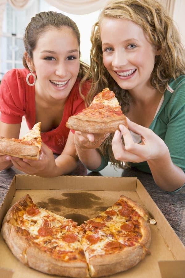 Teenage Girls Eating Pizza stock image