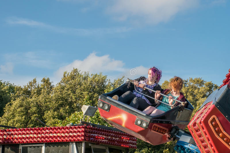Teenage girls on a fairground ride stock image