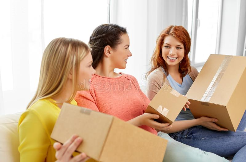 Teenage girls or friends with parcel boxes royalty free stock images