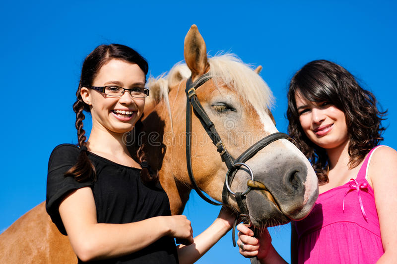 Download Teenage girls with horse stock photo. Image of enjoyment - 18618700