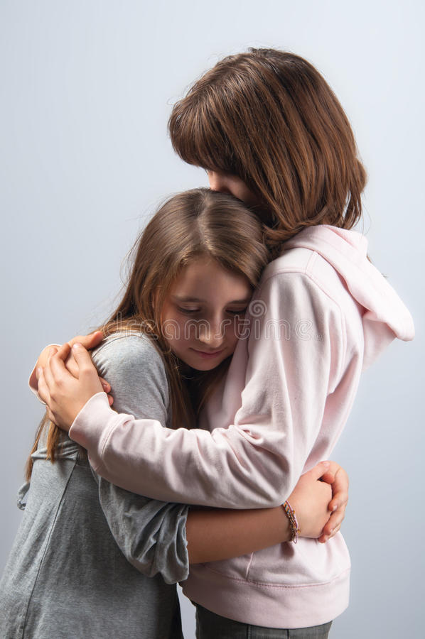 Teenage girls hugging each other. In mutual support royalty free stock photography