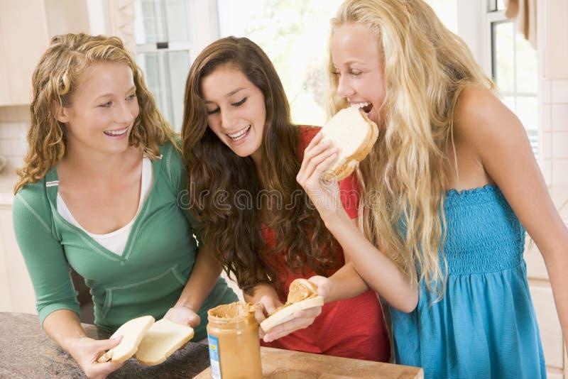 Teenage Girls Making Sandwiches royalty free stock photography