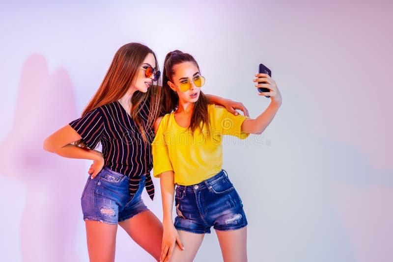 Teenage girls making selfie on smartphone royalty free stock photos