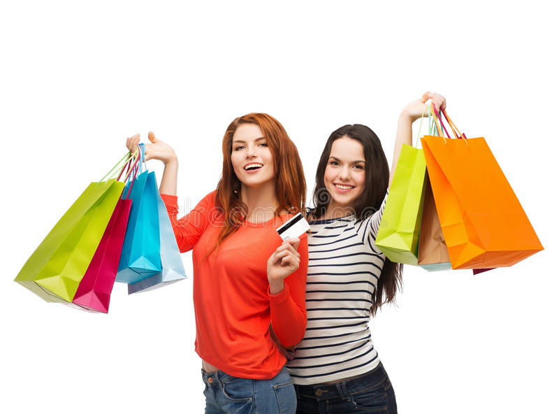 Teenage girls with shopping bags and credit card royalty free stock image