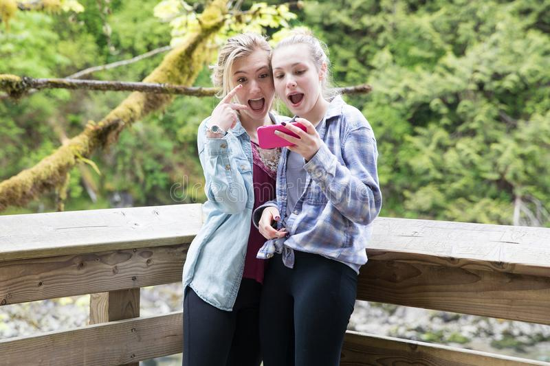 Teenage girls taking a selfie royalty free stock photography