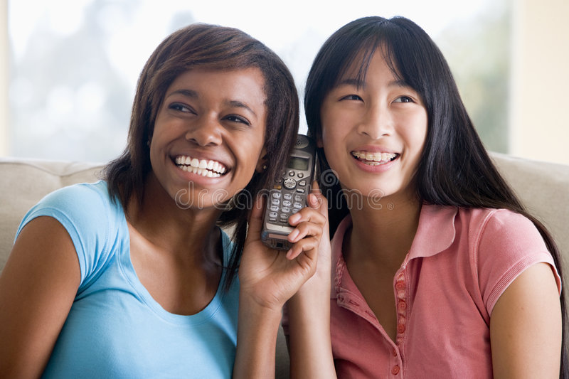 Download Teenage Girls Talking On Telephone Stock Photo - Image of call, braces: 6882924