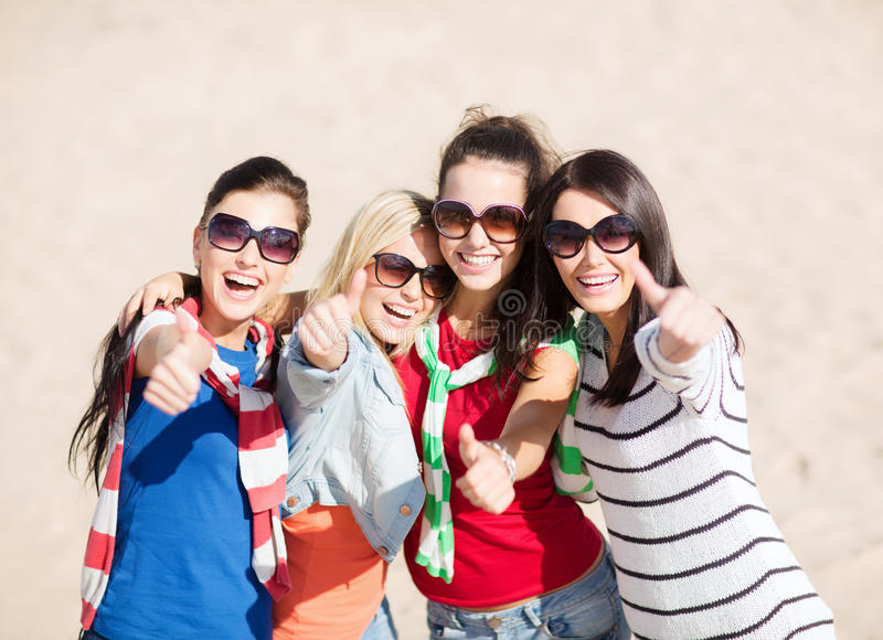 Download Teenage Girls Or Young Women Showing Thumbs Up Stock Photo - Image: 34396332