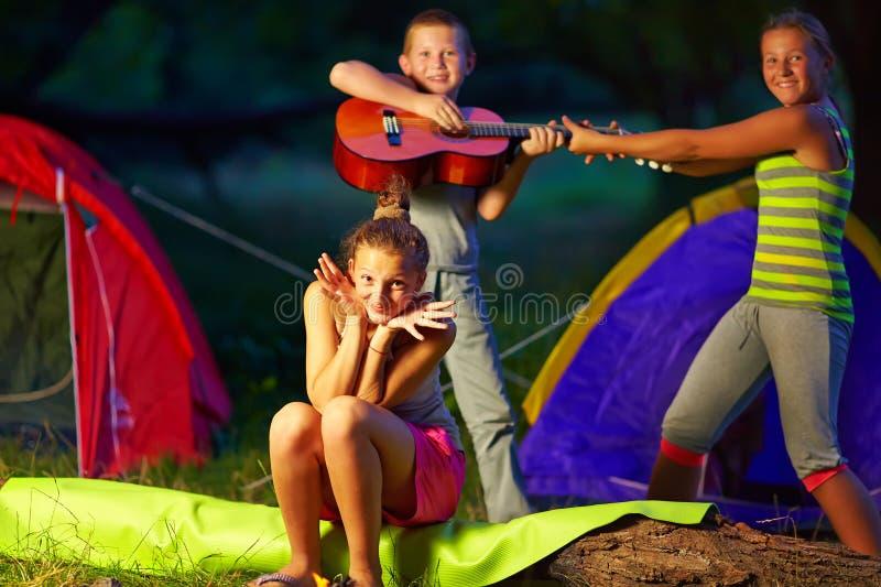 Teenage kids having fun in summer camp. Teenagers kids having fun in summer camp stock photo
