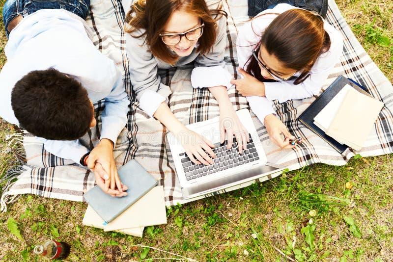 Teenage Kids Studying Outdoors stock photography