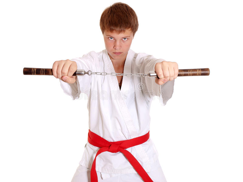 Download Teenage In Kimono Making Exercise With Nun-chuck Royalty Free Stock Photography - Image: 16170207
