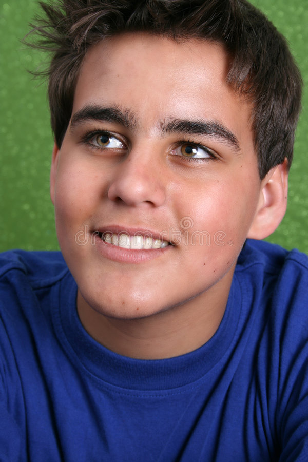 Teenage Male Model. Brunette teenage male against a green background stock images